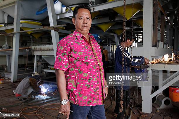 Johan Murod a private tin refiner poses for a photograph on his dredging ship in Pangkal Pinang Bangka Island Indonesia on Thursday July 26 2012 In...