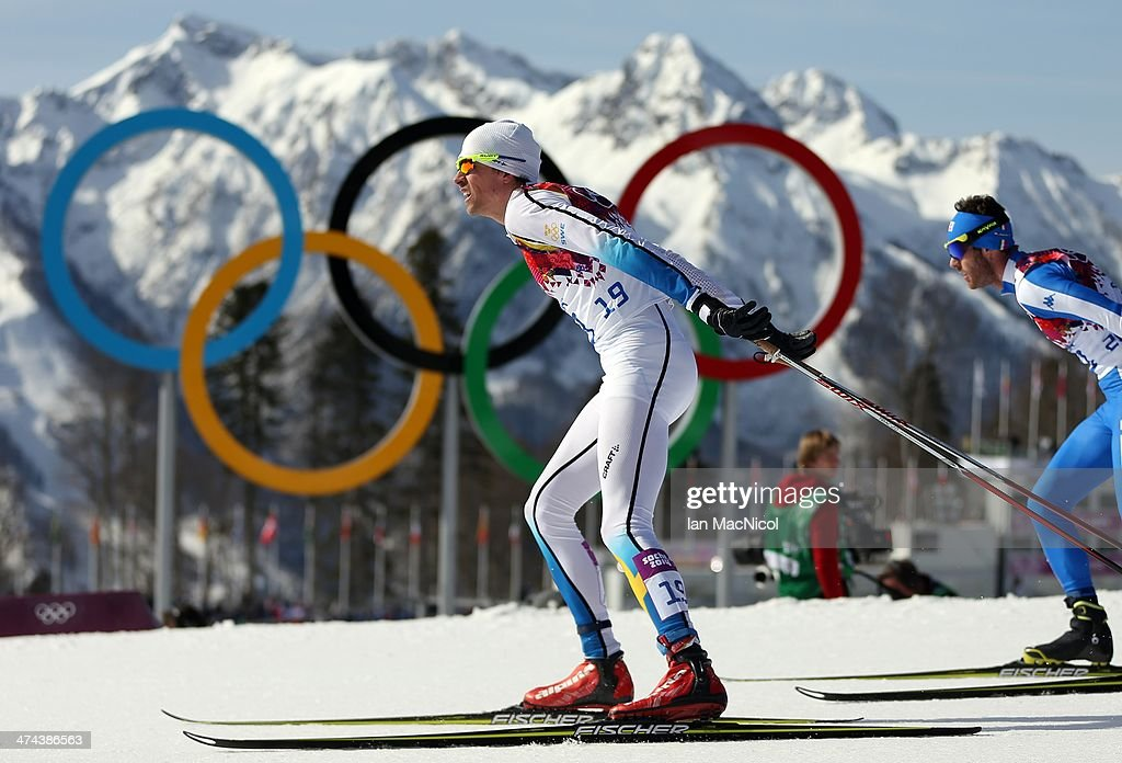 Johan Olsson of Sweden goes past the Olympic rings as he competes in the Men's 50km Mass Start Free on Day 16 of the Sochi 2014 Winter Olympics at Laura Cross-country Ski & Biathlon Center on February 23, 2014 in Sochi, Russia.