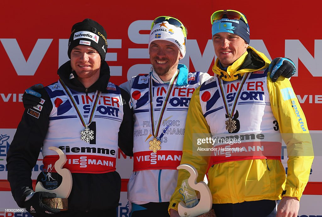 Johan Olsson of Sweden poses with his Gold medal, Dario Cologna of Switzerland (l) his Silver medal and Alexey Poltoranin of Kazakhstan (r) his Bronze medal following the Men's 50Km Cross Country Mass Start at the FIS Nordic World Ski Championships on March 3, 2013 in Val di Fiemme, Italy.