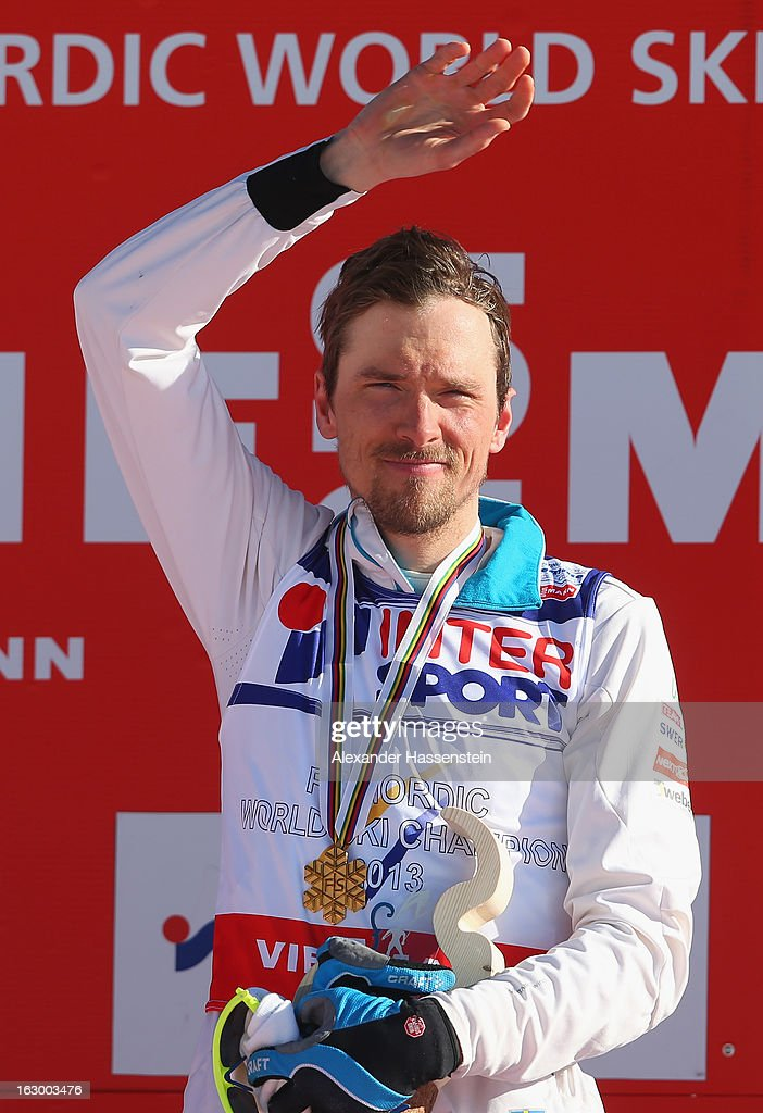 <a gi-track='captionPersonalityLinkClicked' href=/galleries/search?phrase=Johan+Olsson&family=editorial&specificpeople=724246 ng-click='$event.stopPropagation()'>Johan Olsson</a> of Sweden poses with his Gold medal following the Men's 50Km Cross Country Mass Start at the FIS Nordic World Ski Championships on March 3, 2013 in Val di Fiemme, Italy.