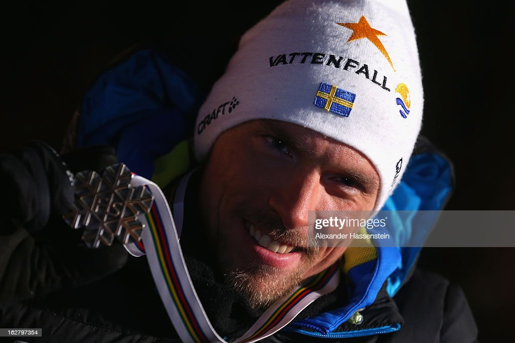 <a gi-track='captionPersonalityLinkClicked' href=/galleries/search?phrase=Johan+Olsson&family=editorial&specificpeople=724246 ng-click='$event.stopPropagation()'>Johan Olsson</a> of Sweden poses with his Silver medal at the medal ceremony for the Men's Cross Country Individual 15km at the FIS Nordic World Ski Championships on February 27, 2013 in Val di Fiemme, Italy.