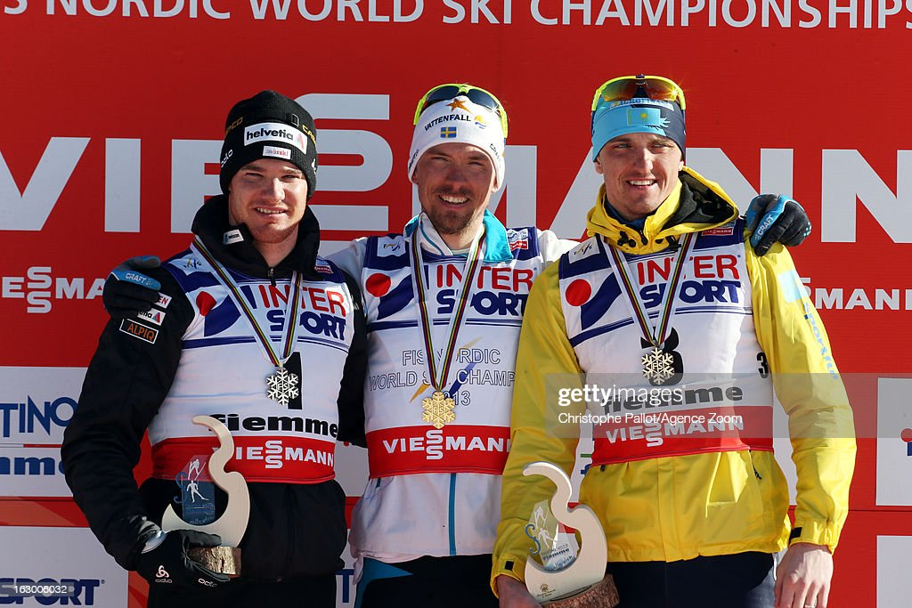 Johan Olsson of Sweden takes the gold medal, Dario Cologna of Switzerland takes the silver medal, Alexey Poltaranin of Kazakstan takes the bronze medal competes during the FIS Nordic World Ski Championships Cross Country Men's Mass Start on March 03, 2013 in Val di Fiemme, Italy.