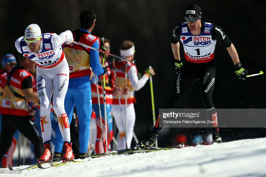 Johan Olsson of Sweden takes the gold medal, Dario Cologna of Switzerland takes the silver medal competes during the FIS Nordic World Ski Championships Cross Country Men's Mass Start on March 03, 2013 in Val di Fiemme, Italy.