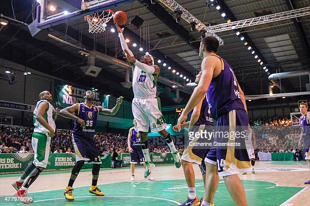 Johan Passave Ducteil of Nanterre is at the basket against Dajuan Summers of Budivelnik Kiev during the game between JSF Nanterre and Budivelnik Kiev...