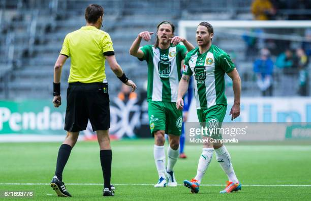 Johan Persson and Bjorn Paulsen of Hammarby IF speak with referee Magnus Lindgren during the Allsvenskan match between Hammarby IF and GIF Sundsvall...