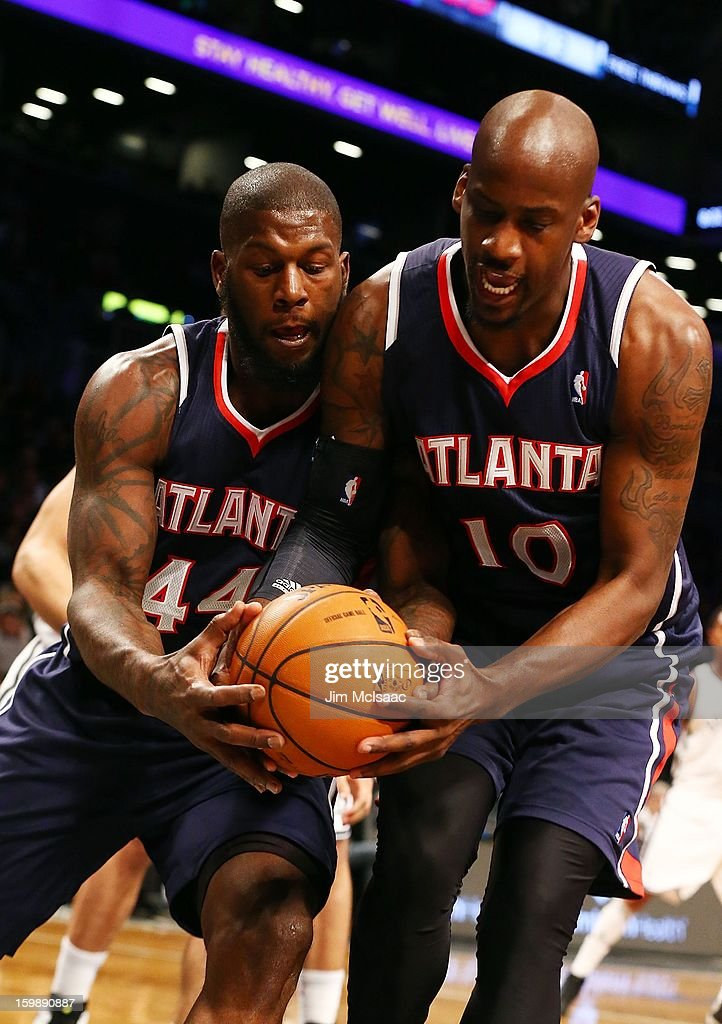 Johan Petro #10 and Ivan Johnson #44 of the Atlanta Hawks in action against the Brooklyn Nets at Barclays Center on January 18, 2013 in the Brooklyn borough of New York City.The Nets defeated the Hawks 94-89.