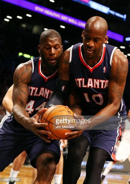 Johan Petro and Ivan Johnson of the Atlanta Hawks in action against the Brooklyn Nets at Barclays Center on January 18 2013 in the Brooklyn borough...