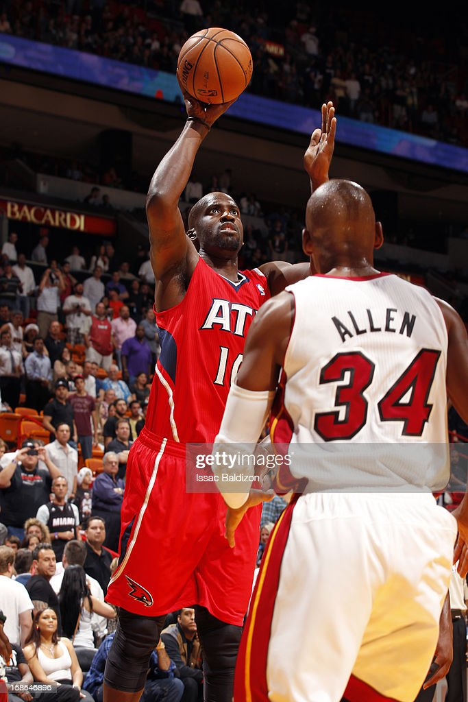 Johan Petro #10 of the Atlanta Hawks shoots against Ray Allen #34 of the Miami Heat during a game on December 10, 2012 at American Airlines Arena in Miami, Florida.
