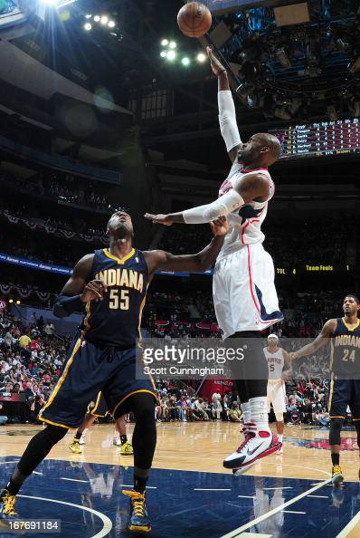 Johan Petro of the Atlanta Hawks shoots the ball against Roy Hibbert of the Indiana Pacers during the Game Three of the Eastern Conference...