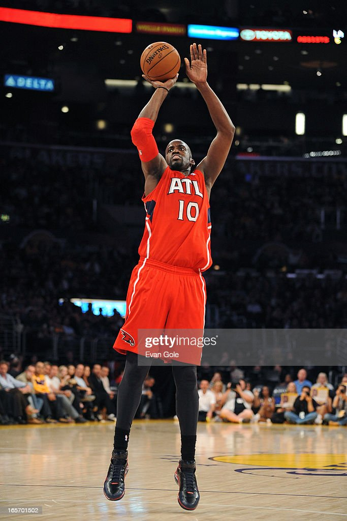 <a gi-track='captionPersonalityLinkClicked' href=/galleries/search?phrase=Johan+Petro&family=editorial&specificpeople=564344 ng-click='$event.stopPropagation()'>Johan Petro</a> #10 of the Atlanta Hawks takes a shot against the Los Angeles Lakers at Staples Center on March 3, 2013 in Los Angeles, California.