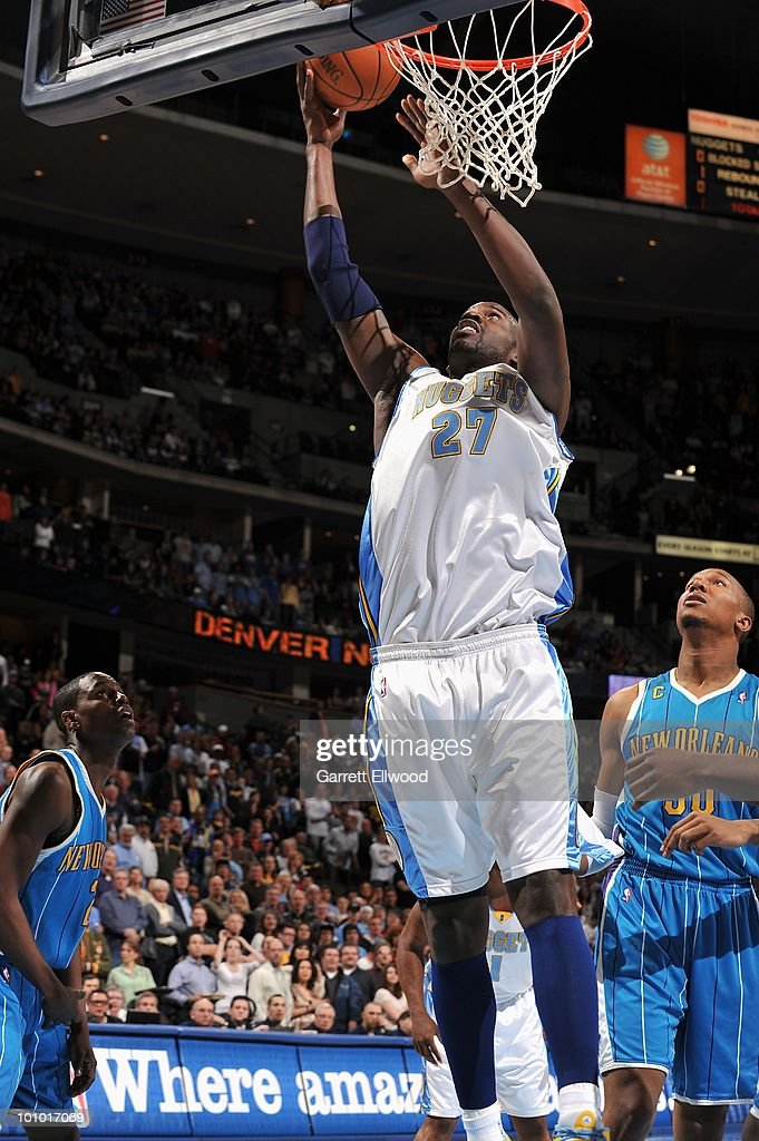 Johan Petro #27 of the Denver Nuggets lays up a shot against the New Orleans Hornets during the game on March 18, 2010 at the Pepsi Center in Denver, Colorado. The Nuggets won 93-80.