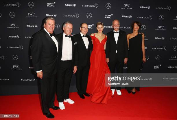 Johan Rupertchairman of Richemont with Prince Albert II of Monaco and his wife CharlenePrincess of Monaco Dr Dieter Zetsche Chairman of the Board of...