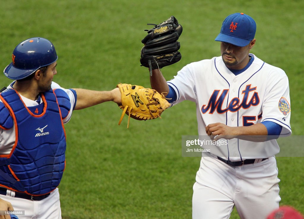 <a gi-track='captionPersonalityLinkClicked' href=/galleries/search?phrase=Johan+Santana&family=editorial&specificpeople=213115 ng-click='$event.stopPropagation()'>Johan Santana</a> #57 and Mike Nickeas #4 of the New York Mets celebrate after an inning against the Arizona Diamondbacks at Citi Field on May 5, 2012 in the Flushing neighborhood of the Queens borough of New York City.