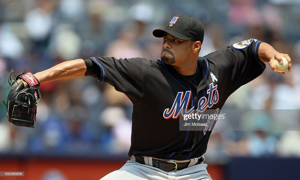 <a gi-track='captionPersonalityLinkClicked' href=/galleries/search?phrase=Johan+Santana&family=editorial&specificpeople=213115 ng-click='$event.stopPropagation()'>Johan Santana</a> #57 of the New York Mets delivers a pitch against the New York Yankees on June 20, 2010 at Yankee Stadium in the Bronx borough of New York City.