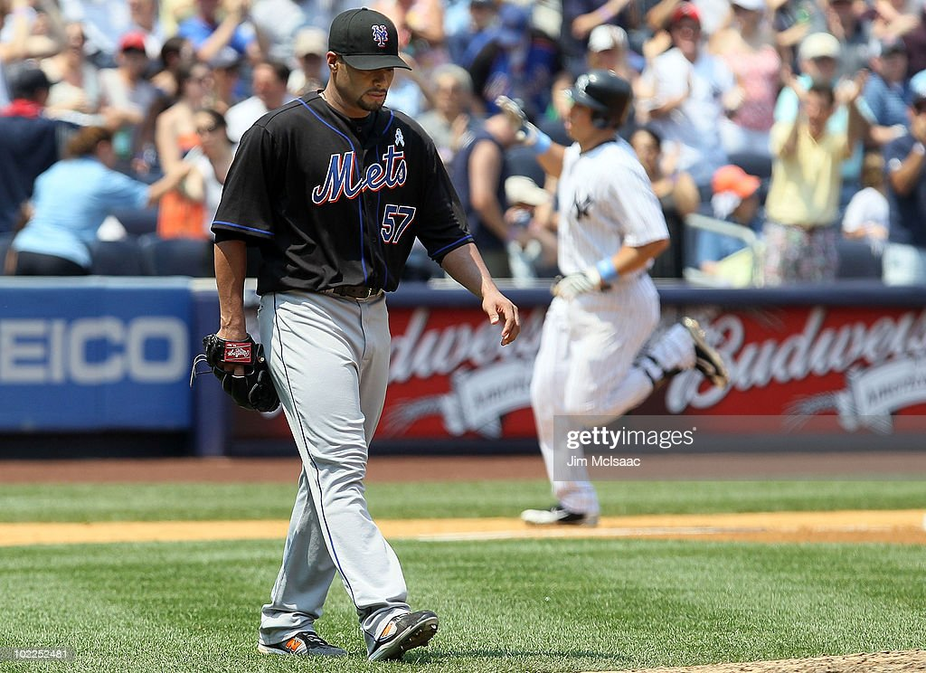 <a gi-track='captionPersonalityLinkClicked' href=/galleries/search?phrase=Johan+Santana&family=editorial&specificpeople=213115 ng-click='$event.stopPropagation()'>Johan Santana</a> #57 of the New York Mets looks on after surrendering a third inning grand slam to <a gi-track='captionPersonalityLinkClicked' href=/galleries/search?phrase=Mark+Teixeira&family=editorial&specificpeople=209239 ng-click='$event.stopPropagation()'>Mark Teixeira</a> #25 of the New York Yankees on June 20, 2010 at Yankee Stadium in the Bronx borough of New York City.