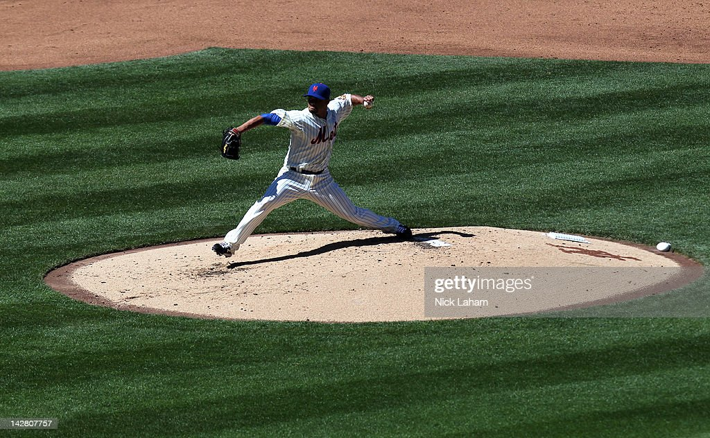 <a gi-track='captionPersonalityLinkClicked' href=/galleries/search?phrase=Johan+Santana&family=editorial&specificpeople=213115 ng-click='$event.stopPropagation()'>Johan Santana</a> #57 of the New York Mets throws a pitch against the Atlanta Braves during their Opening Day Game at Citi Field on April 5, 2012 in New York City.