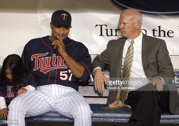 Johan Santana of the Twins and daughter Jasmily and Twins General Manager Terry Ryan get ready for the Cy Young Award presentation April 14 2007 at...