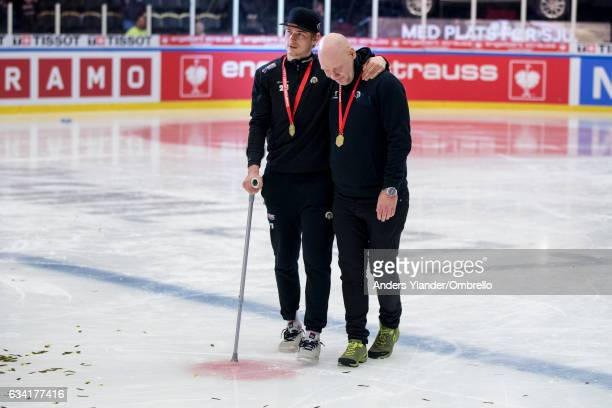 Johan Sundstrom leaves the celebrations injured after a check from behind during the Champions Hockey League Final between Frolunda Gothenburg and...