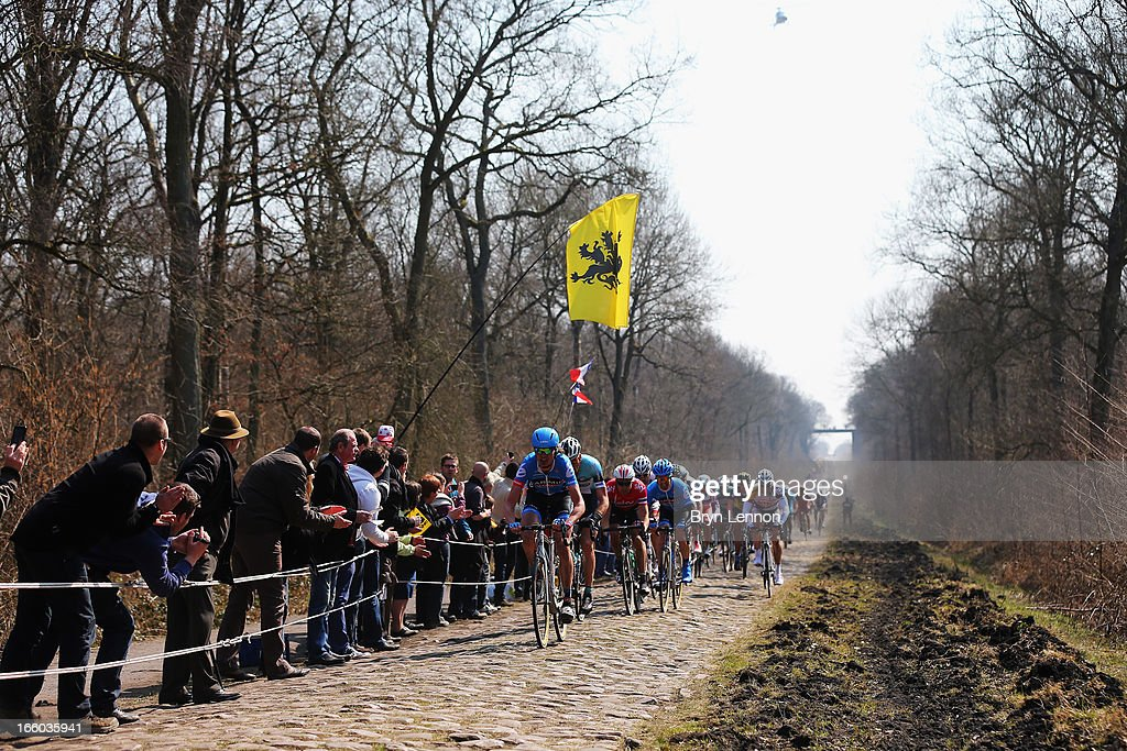 Johan Van Summeren of Belgium and Garmin-Sharp leads the peloton through the Arenberg Forest during the 2013 Paris - Roubaix race from Compiegne to Roubaix on April 7, 2013 in Roubaix, France. The 111th Paris - Roubaix race is 254km long and contains 27 sections of cobblestones.