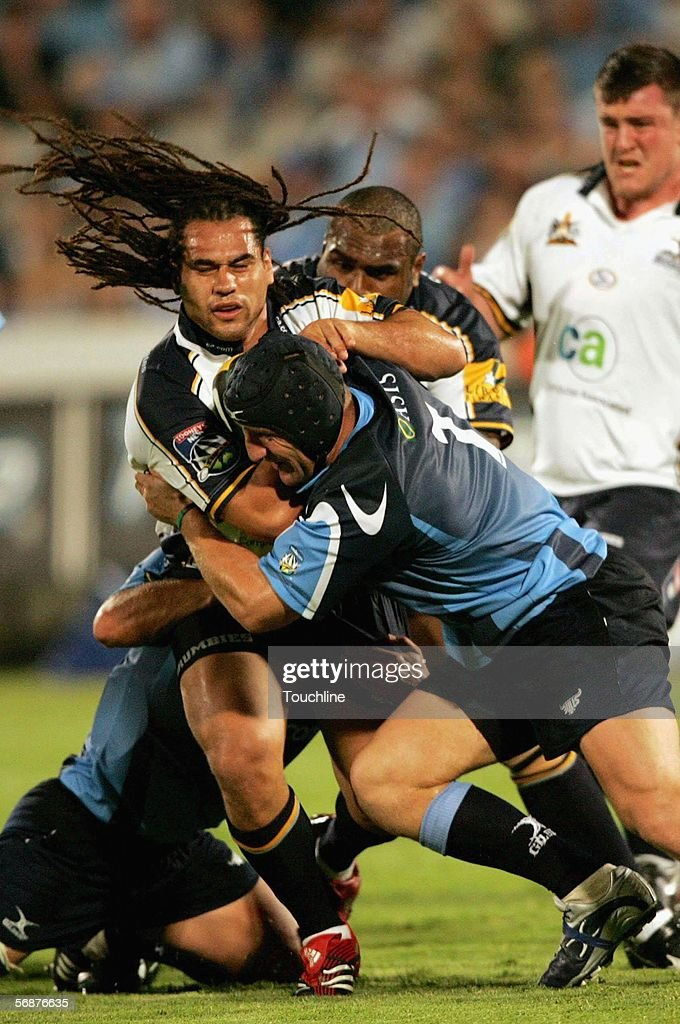 Johan Wasserman tackles George Smith during the Super 14 match between the Vodacom Bulls and the Brumbies at Loftus Versfeld Stadium on February 17...