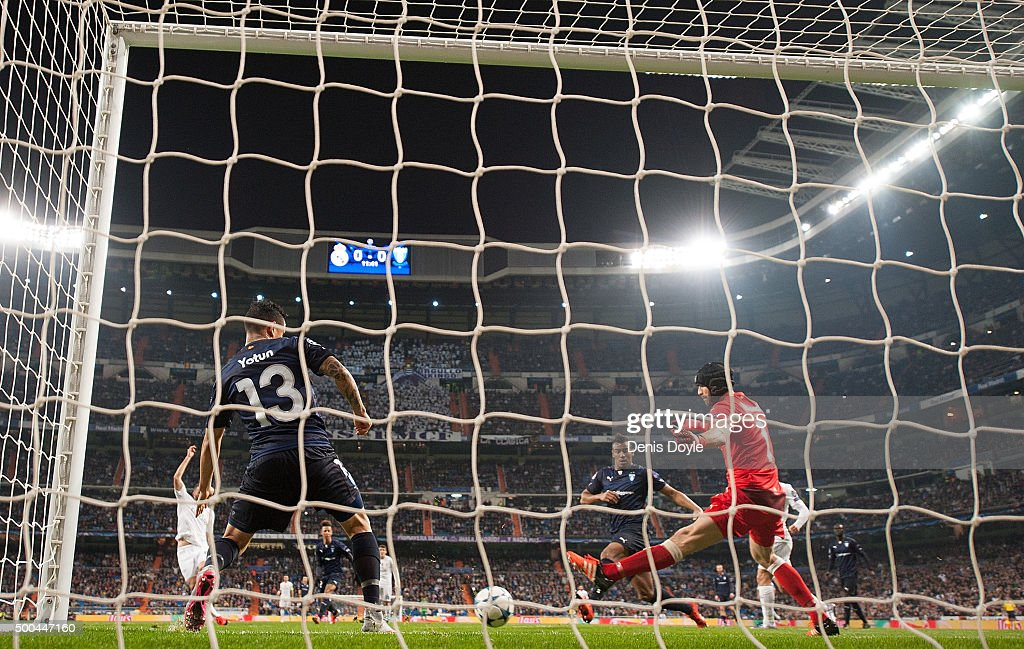 Johan Wiland and Yoshimar Yotun of Malmo FF fail to stop Karim Benzema of Real Madrid scoring Real's opening goal during the UEFA Champions League Group A match between Real Madrid CF and Malmo FF at the Santiago Bernabeu stadium on December 8, 2015 in Madrid, Spain.
