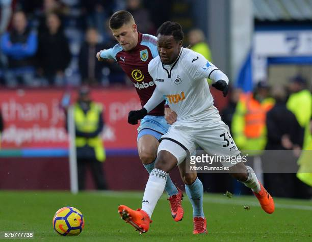 Johann Berg Gudmundsson of Burnley is tackled by Renato Sanches of Swansea City during the Premier League match between Burnley and Swansea City at...
