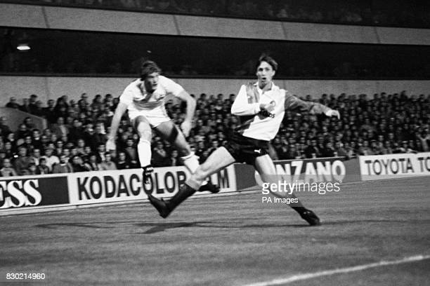 Johann Cruyff of Feyenoord is beaten in a tackle by Tottenham Hotspur's Glenn Hoddle during a UEFA Cup second round first leg game at White Hart Lane...