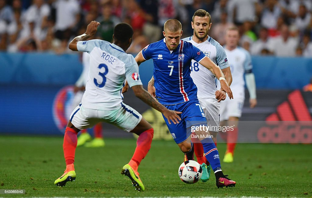 Johann Gudmundsson of Iceland and Danny Rose of England compete for the ball during the UEFA EURO 2016 round of 16 match between England and Iceland at Allianz Riviera Stadium on June 27, 2016 in Nice, France.