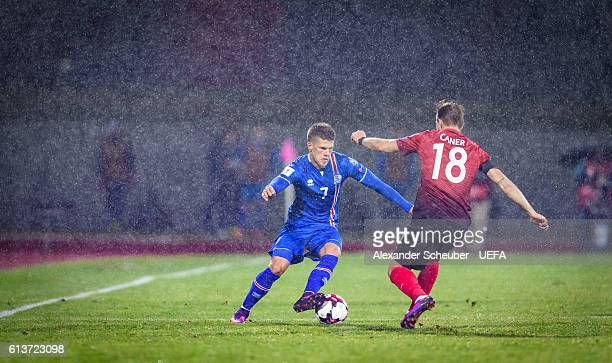 Johann Gudmundsson of Iceland challenges Caner Erkin of Turkey during the FIFA 2018 World Cup Qualifier between Iceland and Turkey at...