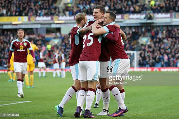 Johann Guomundsson of Burnley celebrates scoring his sides first goal with his Burnley team mates during the Premier League match between Burnley and...