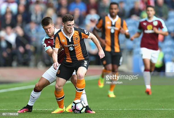 Johann Guomundsson of Burnley puts pressure on Andrew Robertson of Hull City during the Premier League match between Burnley and Hull City at Turf...