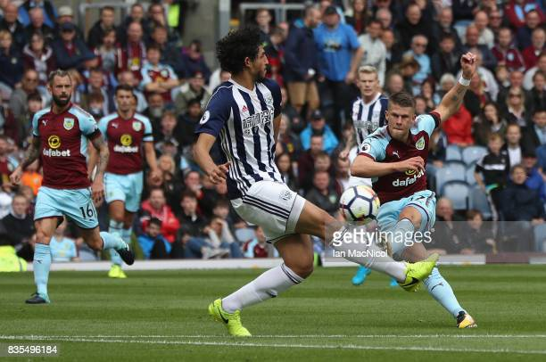 Johann Guomundsson of Burnley shoots during the Premier League match between Burnley and West Bromwich Albion at Turf Moor on August 19 2017 in...