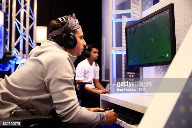 Johann 'Maniika' Simon of France in action in his game against Marcus 'Marcus_7170' Gomes of Australia during day one of the FIFA Interactive World...
