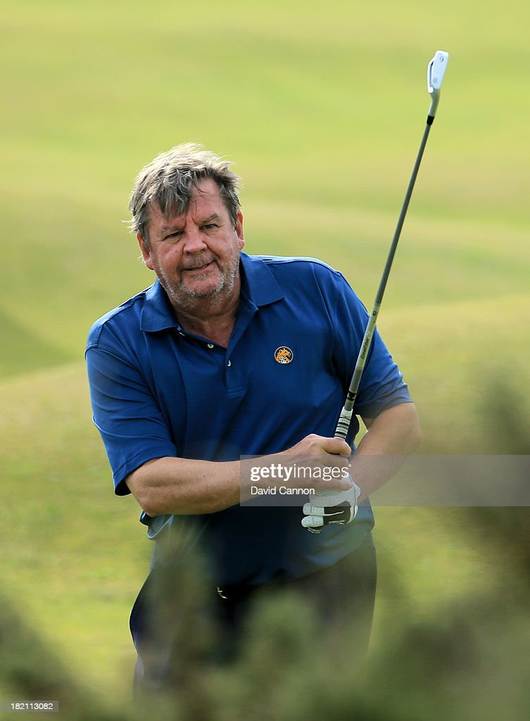 Johann Rupert plays second shot to the fourth hole during the third round of the Alfred Dunhill Links Championship on The Old Course, at St Andrews on September 28, 2013 in St Andrews, Scotland.
