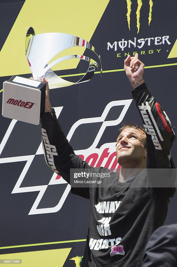 <a gi-track='captionPersonalityLinkClicked' href=/galleries/search?phrase=Johann+Zarco&family=editorial&specificpeople=4501201 ng-click='$event.stopPropagation()'>Johann Zarco</a> of France and Ajo Motorsport celebrates the victory on the podium and looks the sky for remembers Luis Salom of Spain and SAG Team at the end of the Moto2 race during the MotoGp of Catalunya - Race at Circuit de Catalunya on June 5, 2016 in Montmelo, Spain.