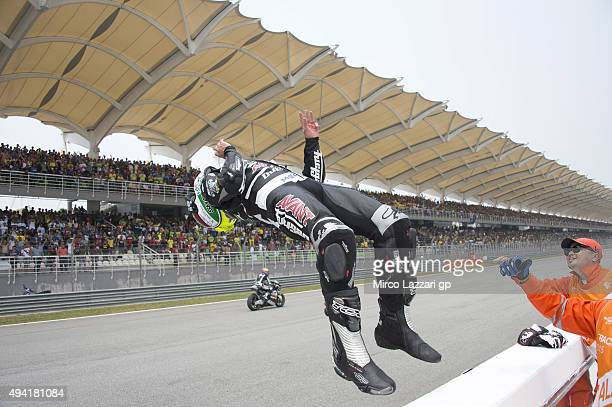 Johann Zarco of France and AJO Motorsport celebrates the victory with jump at the end of the Moto2 race during the MotoGP Of Malaysia at Sepang...