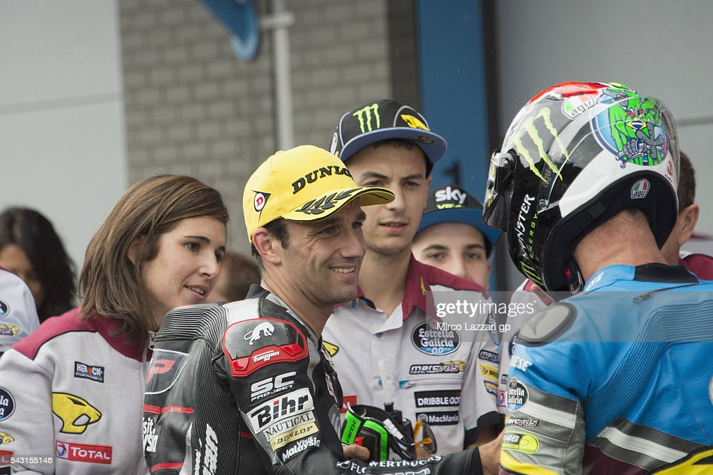 <a gi-track='captionPersonalityLinkClicked' href=/galleries/search?phrase=Johann+Zarco&family=editorial&specificpeople=4501201 ng-click='$event.stopPropagation()'>Johann Zarco</a> (L) of France and Ajo Motorsport celebrates with Franco Morbidelli of Italy and Estrella Galicia 00 Marc VDS Racing Team at the end of the Moto2 race during the MotoGP Netherlands - Race at on June 26, 2016 in Assen, Netherlands.