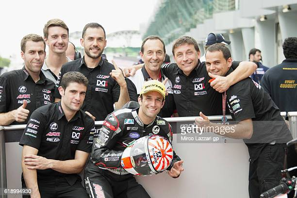 Johann Zarco of France and Ajo Motorsport celebrates with team at the end of the qualifying practice during the MotoGP Of Malaysia Qualifying at...
