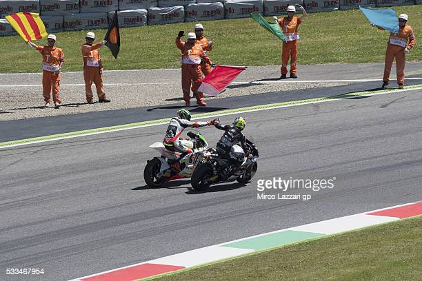 Johann Zarco of France and Ajo Motorsport congratulates with Lorenzo Baldassarri of Italy and Forward Team at the end of the Moto2 race during MotoGp...