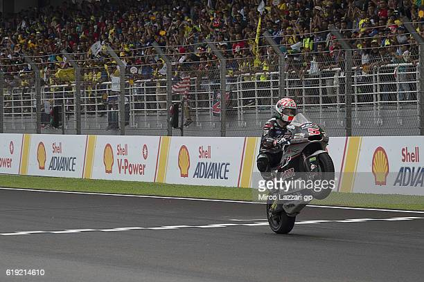 Johann Zarco of France and Ajo Motorsport cuts the finish lane and celebrates the victory and become the 2016 Moto2 Champion at the end of the Moto2...