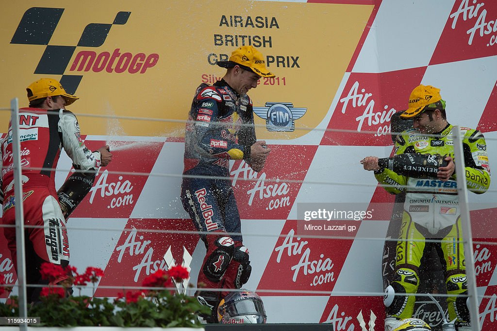 Johann Zarco of France and Avant Air Asia Ajo, Jonas Folger of Germany and Red Bull Ajo Motorsport and Hector Faubel of Spain and Aspar Team celebrate on the podium at the end of the 125 cc race of MotoGp Of Great Britain at Silverstone Circuit on June 12, 2011 in Northampton, England.