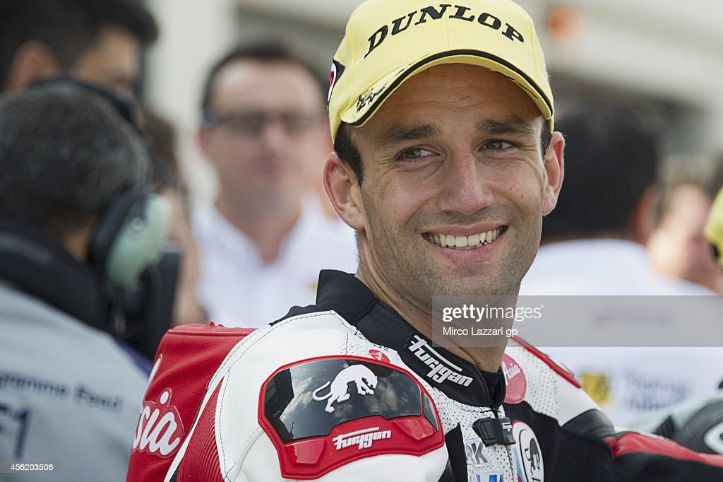 <a gi-track='captionPersonalityLinkClicked' href=/galleries/search?phrase=Johann+Zarco&family=editorial&specificpeople=4501201 ng-click='$event.stopPropagation()'>Johann Zarco</a> of France and Caterham Moto Racing smiles at the end of the MotoGP of Spain Moto2 qualifying practice at Motorland Aragon Circuit on September 27, 2014 in Alcaniz, Spain.