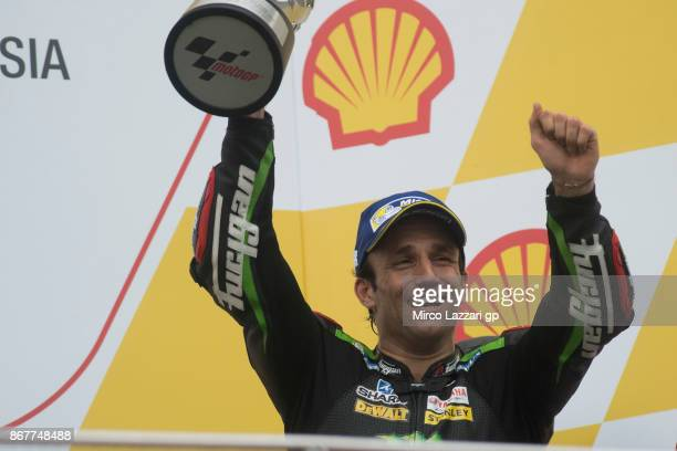 Johann Zarco of France and Monster Yamaha Tech 3 celebrates the third place on the podium at the end of the MotoGP race during the MotoGP Of Malaysia...