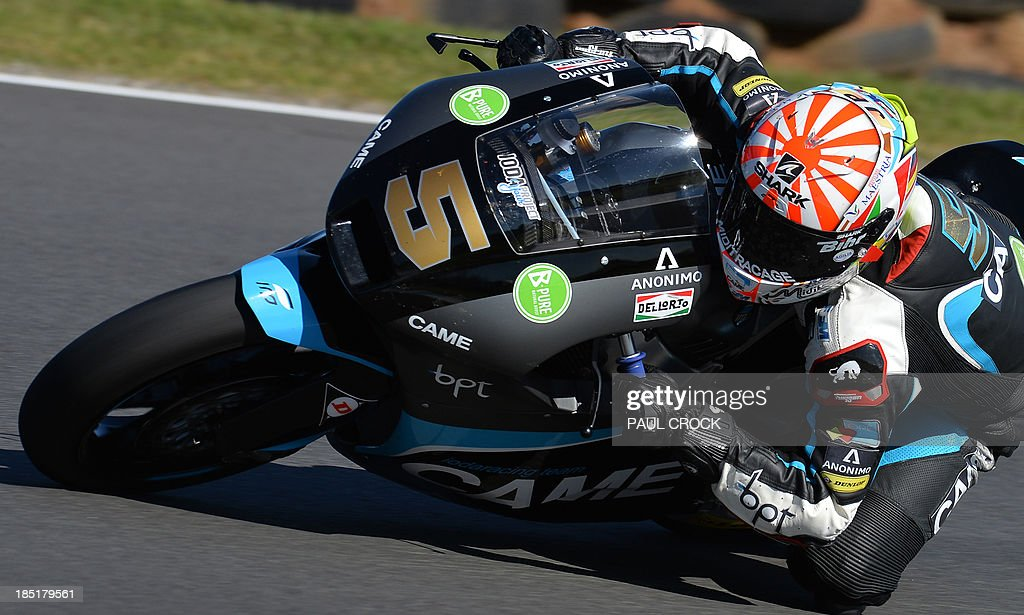 Johann Zarco of France races his Suter through a corner during practice for the Australian Moto2 Grand Prix at Phillip Island on October 18, 2013. AFP PHOTO/Paul Crock USE