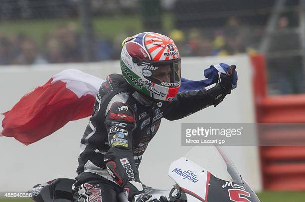 Johann Zarco of French and AJO Motorsport celebrates the victory with flag at the end of the Moto2 race during the MotoGp Of Great Britain Race at...