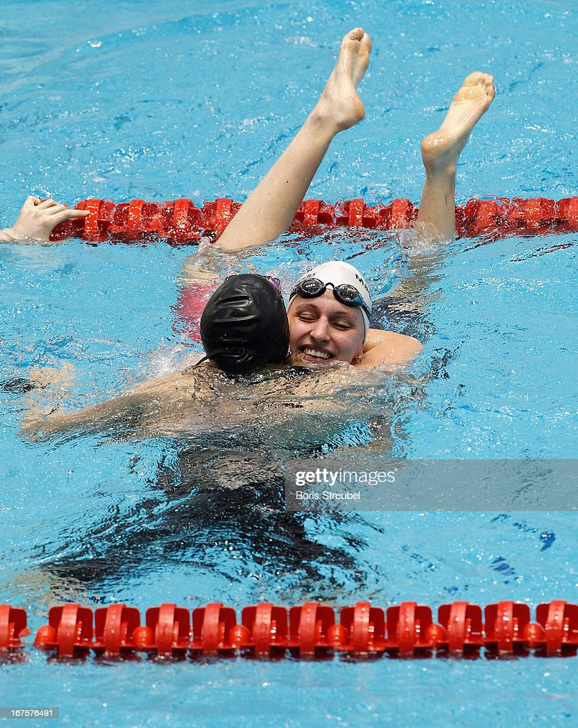 Johanna Friedrich (R) of SC Magdeburg congratulates Sarah Koehler of SG Frankfurt on winning the women's 400m freestyle A final during day one of the German Swimming Championship 2013 at the Eurosportpark on April 26, 2013 in Berlin, Germany.