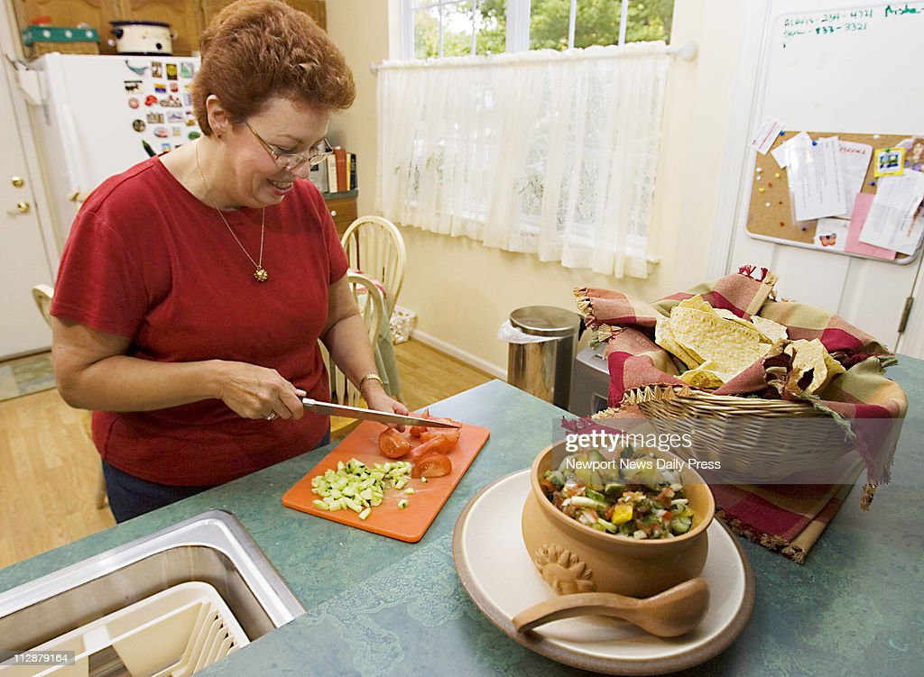 Johanna Hahn of Newport News Virginia chops up tomatoes and a cucumber to make her prizewinning salsa