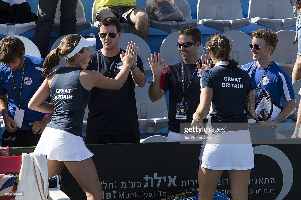 Johanna Konta and Laura Robson of Great Britain celebrate with team mates after victory in the tie between Great Britain and Bosnia and Herzegovina during the Fed Cup Europe/Africa Group One fixture at the Municipal Tennis Club on February 7, 2013 in Eilat, Israel.