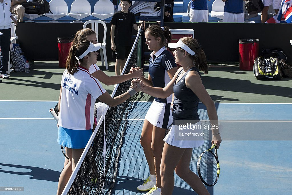 Johanna Konta and Laura Robson of Great Britain shake hands after a victory in their tie between Great Britain and Bosnia and Herzegovina during the Fed Cup Europe/Africa Group One fixture at the Municipal Tennis Club on February 7, 2013 in Eilat, Israel.