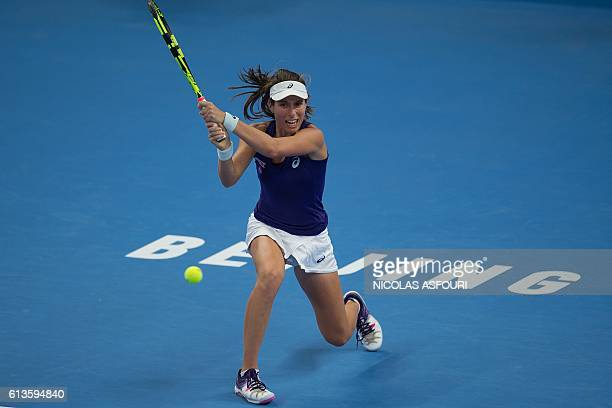 Johanna Konta of Britain hits a return to Agnieszka Radwanska of Poland in their women's singles final match of the China Open tennis tournament in...
